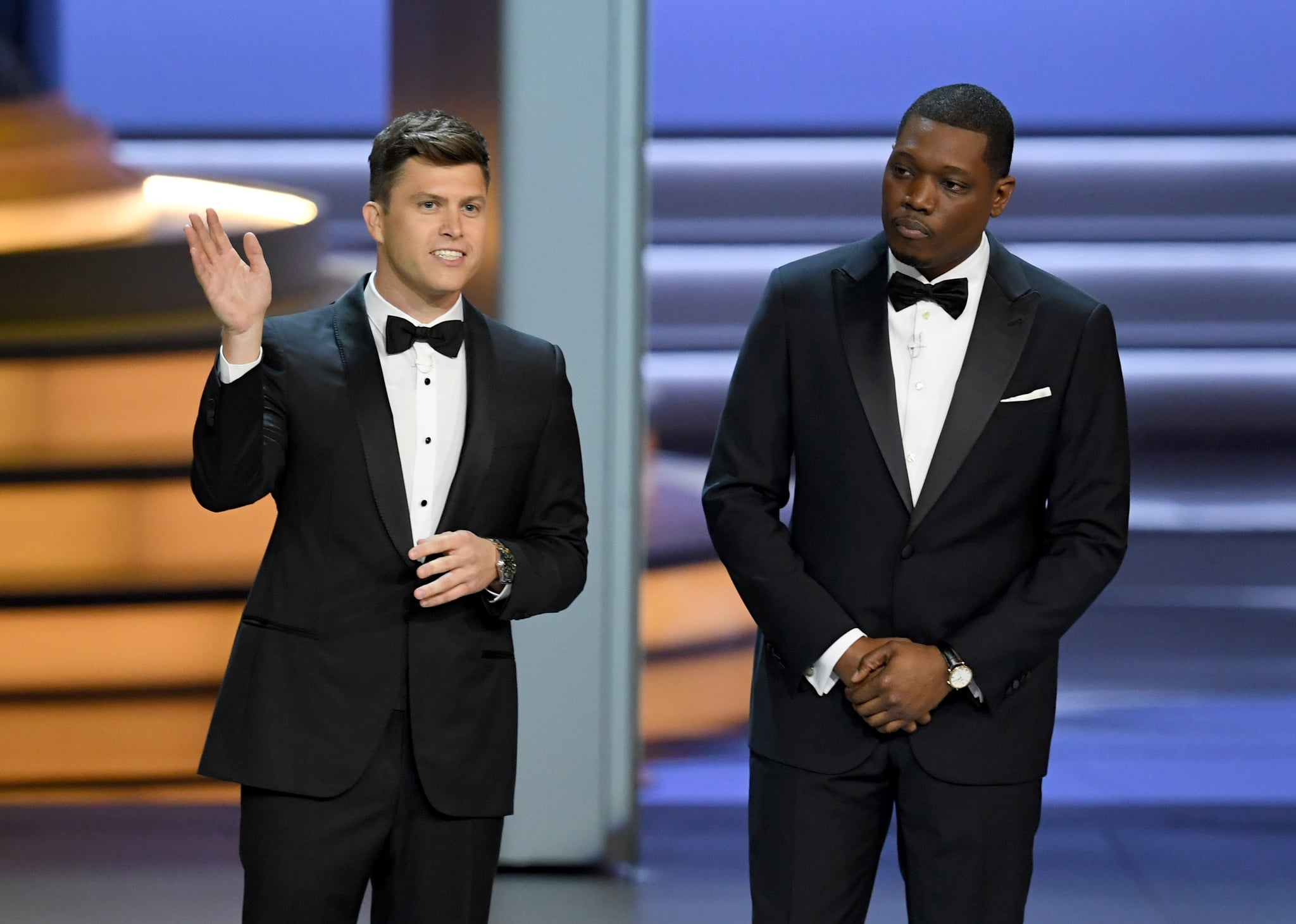 LOS ANGELES, CA - SEPTEMBER 17:  Colin Jost (L) and Michael Che speak onstage during the 70th Emmy Awards at Microsoft Theatre on September 17, 2018 in Los Angeles, California.  (Photo by Kevin Winter/Getty Images)