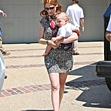 January Jones, who sported new red hair, carried her son, Xander Jones, home from a party.
