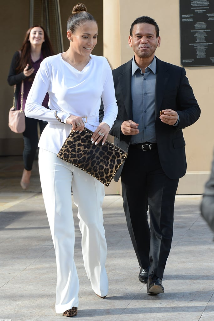 Jennifer Lopez paired a leopard clutch and heels with an all-white ensemble for lunch with her manager, Benny Medina, in LA yesterday. She left the restaurant smiling as she chatted with Benny on the way to her car. It's been quite a month for Jennifer, who has been busy promoting her latest film, Parker, around the US last week. Jennifer wore a revealing sheer dress to premiere the film in Las Vegas with costar Jason Statham, and she also debuted the movie in NYC. While she was in the Big Apple, she fit in stops on The Daily Show and Good Morning America. Through it all she had the support of her boyfriend, Casper Smart, who was also by her side over the weekend when Jennifer spent time with fans in Santa Monica.