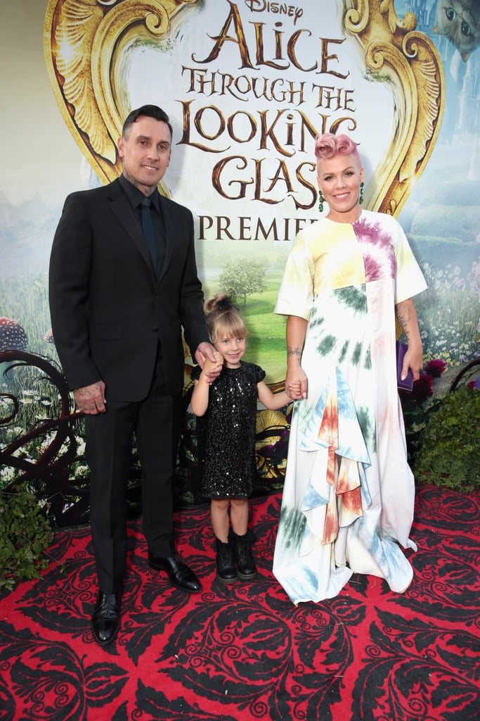 "Following her stunning performance at the Billboard Music Awards, Pink attended Monday's LA premiere of Alice Through the Looking Glass with her husband, Carey Hart, and daughter, Willow Sage, by her side. While the singer — whose song ""Just Like Fire"" is featured in the movie — kept things colorful in a white tie-dye dress, Carey and Willow did the opposite in all-black ensembles. The event also brought out the movie's cast, including Anne Hathaway and Johnny Depp, and marked the second time little Willow has hit a red carpet. Keep reading for a closer look at the family."