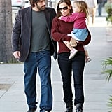 Jennifer Garner carries Seraphina during a day out in LA with Ben Affleck.