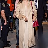 Angelina Wearing the Pumps With a Neutral Trench Coat and Valentino Bag