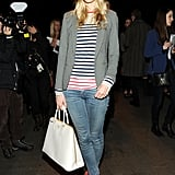 Poppy Delevingne sported a striped top with a structured blazer, skinny jeans, red studded boots, and a black hat at Rag & Bone's show.