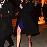 Julia let an indigo slitted minidress, which matched her platform heels, peek out from a long coat during a night out in New York in December 2013.