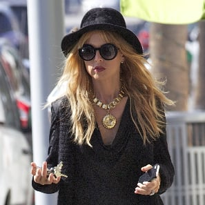 Rachel Zoe Wearing Long Black Sweater