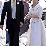 George's wedding outfit doesn't look that different from his usual getup, but Lucy looks wonderful.