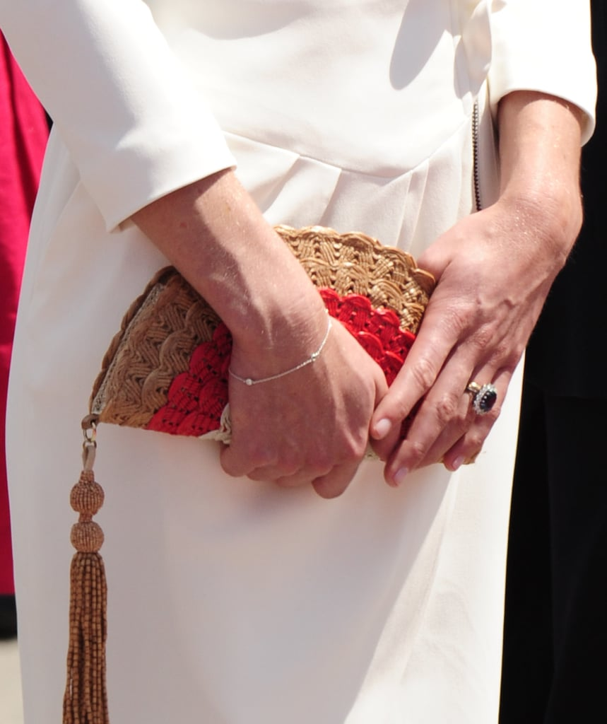 How cool is her woven fan-shaped Anya Hindmarch clutch?