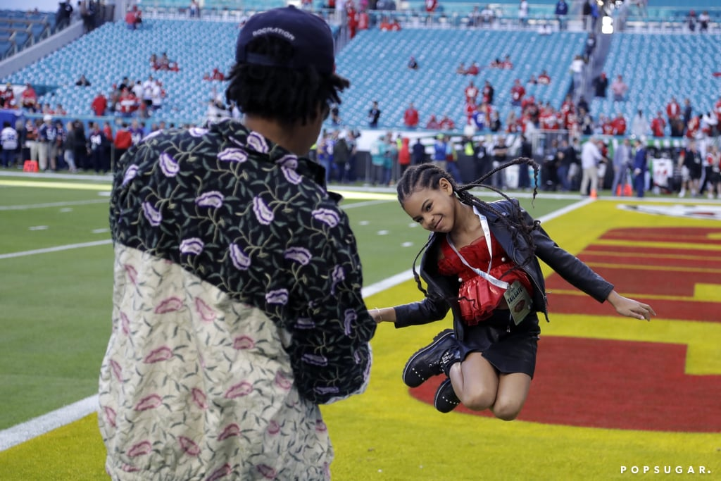 I'm not saying Blue Ivy Carter invented the Super Bowl, but I'm also not not saying it. Beyoncé and JAY-Z's oldest daughter stole the show as she took the field with her dad before Sunday's game in Miami, and it's difficult to think of anything better than seeing Blue toss a football on the sport's biggest night.  JAY-Z's entertainment agency, ROC Nation, teamed up with the NFL for the game between the San Francisco 49ers and the Kansas City Chiefs. After snapping some photos of Blue on the turf, the duo joined Beyoncé in the stands to enjoy the night. Shortly after the game, Bey shared a few snaps of her green suit and behind-the-scenes moments with her family during the game. See more of their fun outing ahead.       Related:                                                                                                           Demi Lovato Just Conquered the Demanding Gig of Super Bowl National Anthem Performer