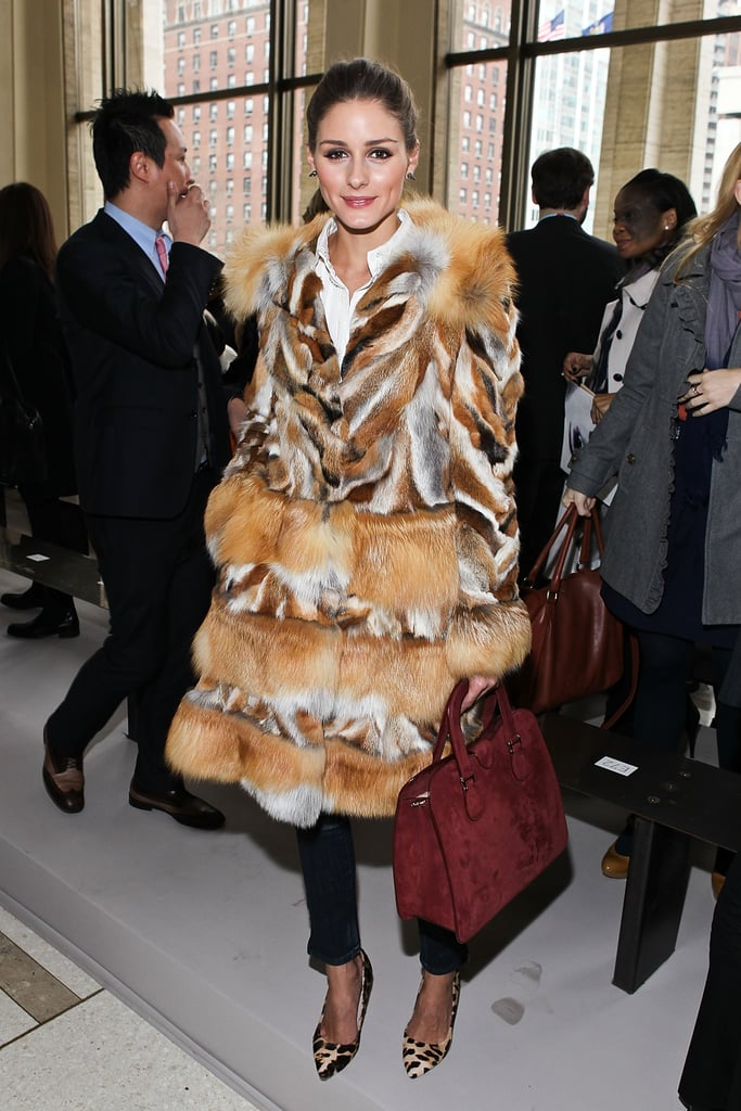 Olivia Palermo cozied up in a statement fur coat and leopard print pumps at the Philosophy Di Alberta Ferretti show.