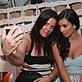 Kim Kardashian and her sister Khloé snapped selfies (with an actual camera!) during Miami Swim Fashion Week in July 2007.