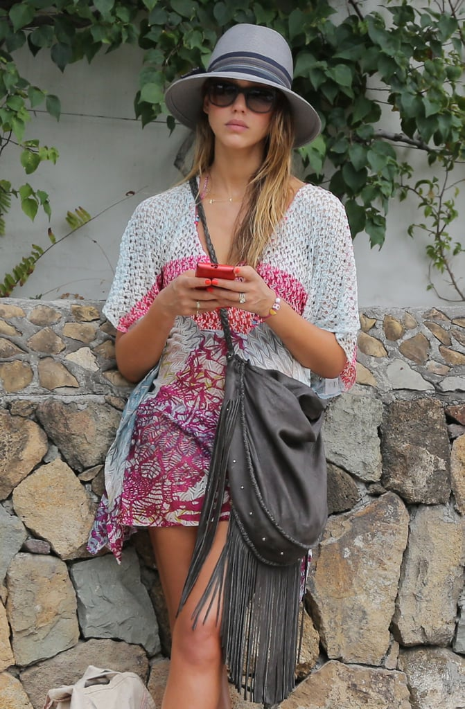 Jessica Alba matched her gray fringe purse with a gray fedora in St. Barts.