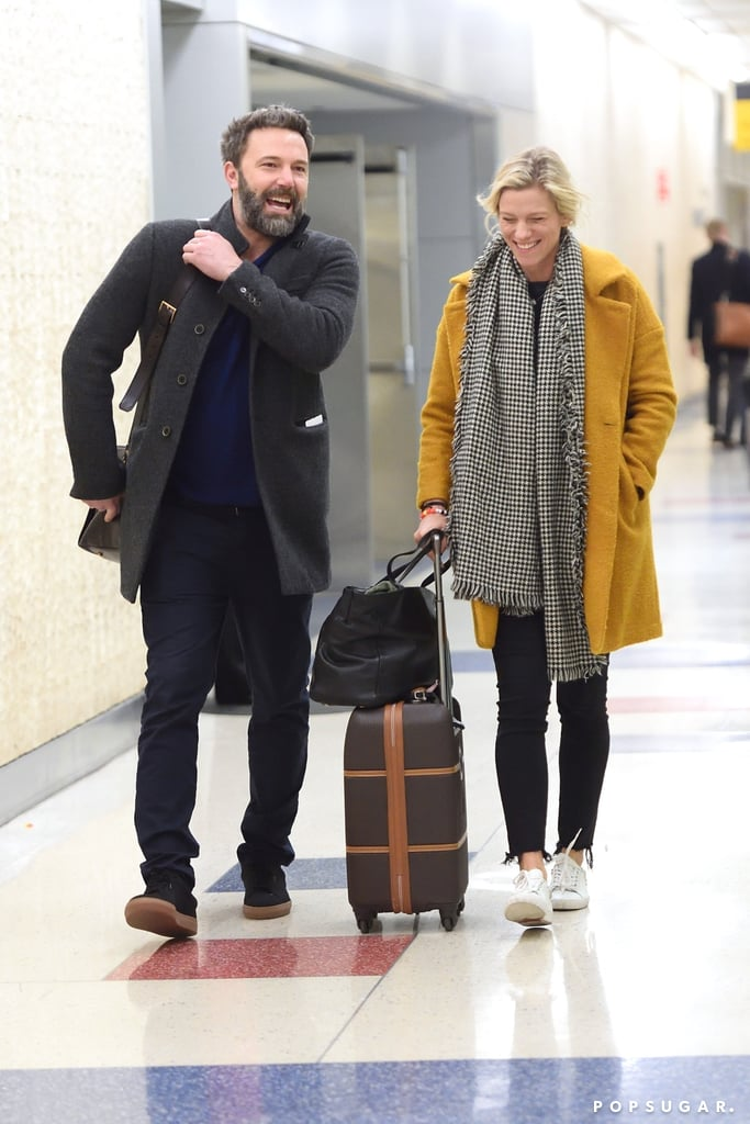 Ben Affleck and Lindsay Shookus caught a case of the giggles when they arrived at JFK airport in NYC on Wednesday night. The couple were all smiles as they strolled through the terminal with their luggage. Ben, who is in the process of divorcing Jennifer Garner, stopped for doughnuts and coffee with his girlfriend before heading out. His romance with the Saturday Night Live producer reportedly began back in 2013 while he was still married to Jennifer. The couple have since gone public with their relationship following the announcement of Ben's divorce in June 2015, making appearances at the Emmys and the US Open Tennis Championships in September.        Related:                                                                                                           All the Times Ben and Jen Have Been Spotted Together Since Their Split