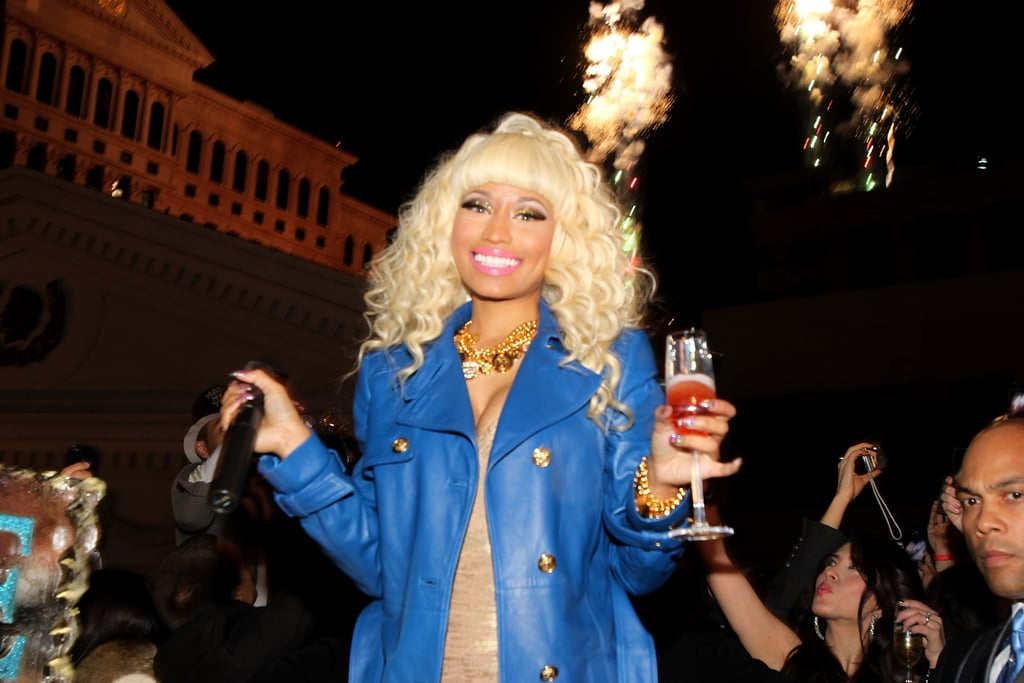 Nicki Minaj was all smiles with her pink Champagne while hosting a New Year's Eve party at Pure Nightclub in Las Vegas in 2012.