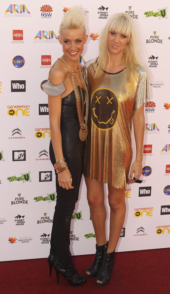 The Nervo girls aren't afraid of a metallic moment on the red carpet.