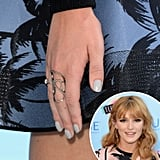 Usually one for outlandish manicures, Bella Thorne kept things demure with a dusty gray hue on her nails.