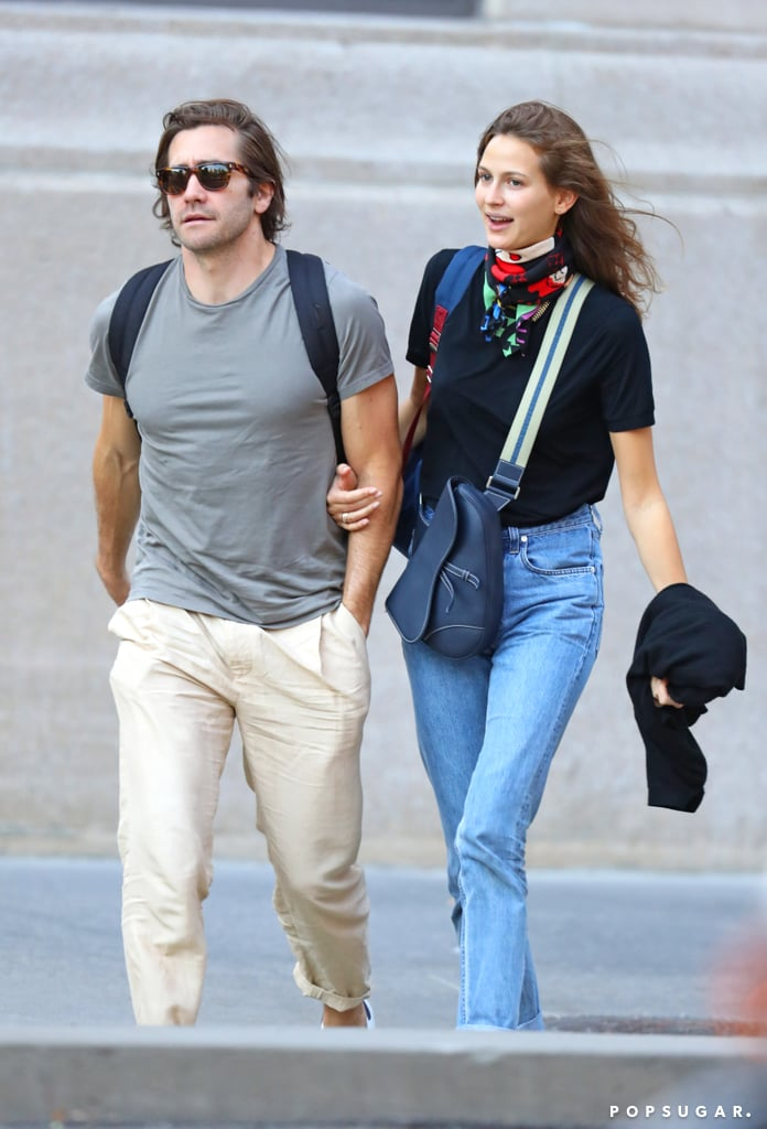 "Jake Gyllenhaal and Jeanne Cadieu are still going strong! The couple — who were first linked together in December 2018 — were spotted on a casual stroll in NYC on Monday afternoon. The 38-year-old actor and 23-year-old model walked arm-in-arm before stopping so Jeanne could fix Jake's hair.  Jake and Jeanne have been together for almost a year now, and according to Us Weekly, things are ""pretty serious."" ""Jeanne is very mature for her age. She's quirky, smart and loves history, reading; she's a really great and well-rounded person,"" a source told the outlet. ""She and Jake really took things slow, but are now pretty serious."" Jake and Jeanne are usually private when it comes to their romance; however, they were spotted getting cozy together in Paris last December.       Related:                                                                                                           25 Pictures of Young Jake Gyllenhaal That Will Make Your Day 50% Better"
