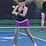 Reese Witherspoon held a racket.