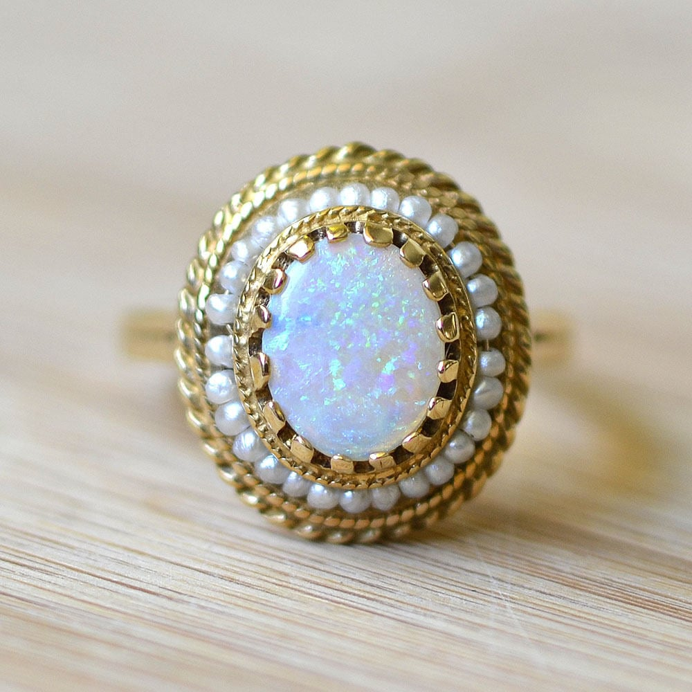 For a subtler touch, this opal ring features seed pearls ($1,950), giving off a beautiful vintage feel.