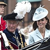 Prince Charles and Kate sat side by side during a carriage procession in 2014.