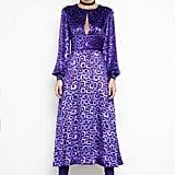 Geometric Devore Velvet Dress in Peacock Purple ($995), Sweet Revenge Stretch Suede Legging Boot in Purple ($2,395) Photo courtesy of Tamara Mellon