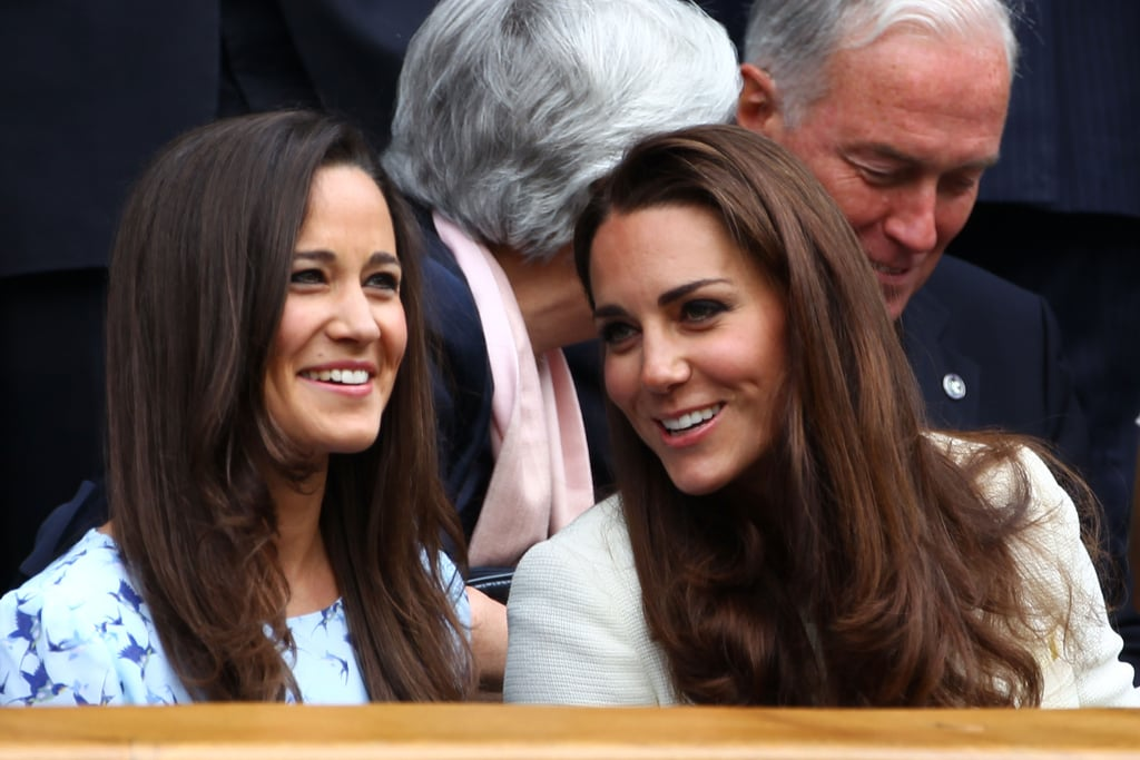 The sisters chatted and laughed while taking in a match between Roger Federer and Andy Murray during Wimbledon in 2012.