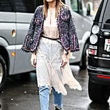 Layer a sheer, chiffon dress over your jeans and cover up with a tweed blazer.