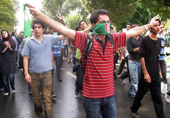 Front Page: Iranians Clash as Ahmadinejad Denies Holocaust