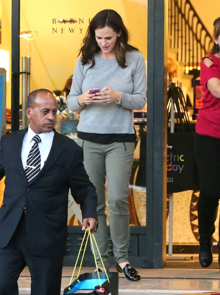 Jennifer Garner texted on her cell phone leaving Barneys.