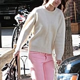 Katie Holmes's pink jeans were darling, while an ivory sweater provided warmth and style. This outfit is super simple and even easier to re-create: just pair similar pink jeans with an ivory top, then finish off with taupe booties. Check out Katie's entire look on POPSUGAR.
