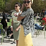 Pops of mellow yellow counteracted the high-impact of her sequined top.