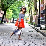 A Striped Shirt, Bold Coloured Skirt, and Sandals