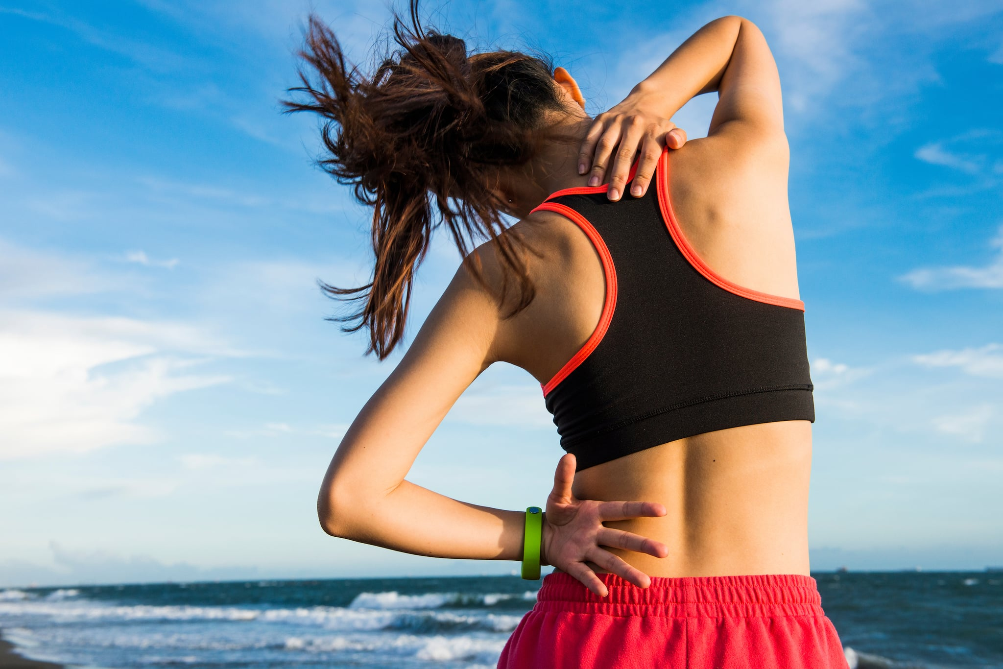 4 Exercises to Help Reduce Middle-Back Pain, According to a Physical Therapist