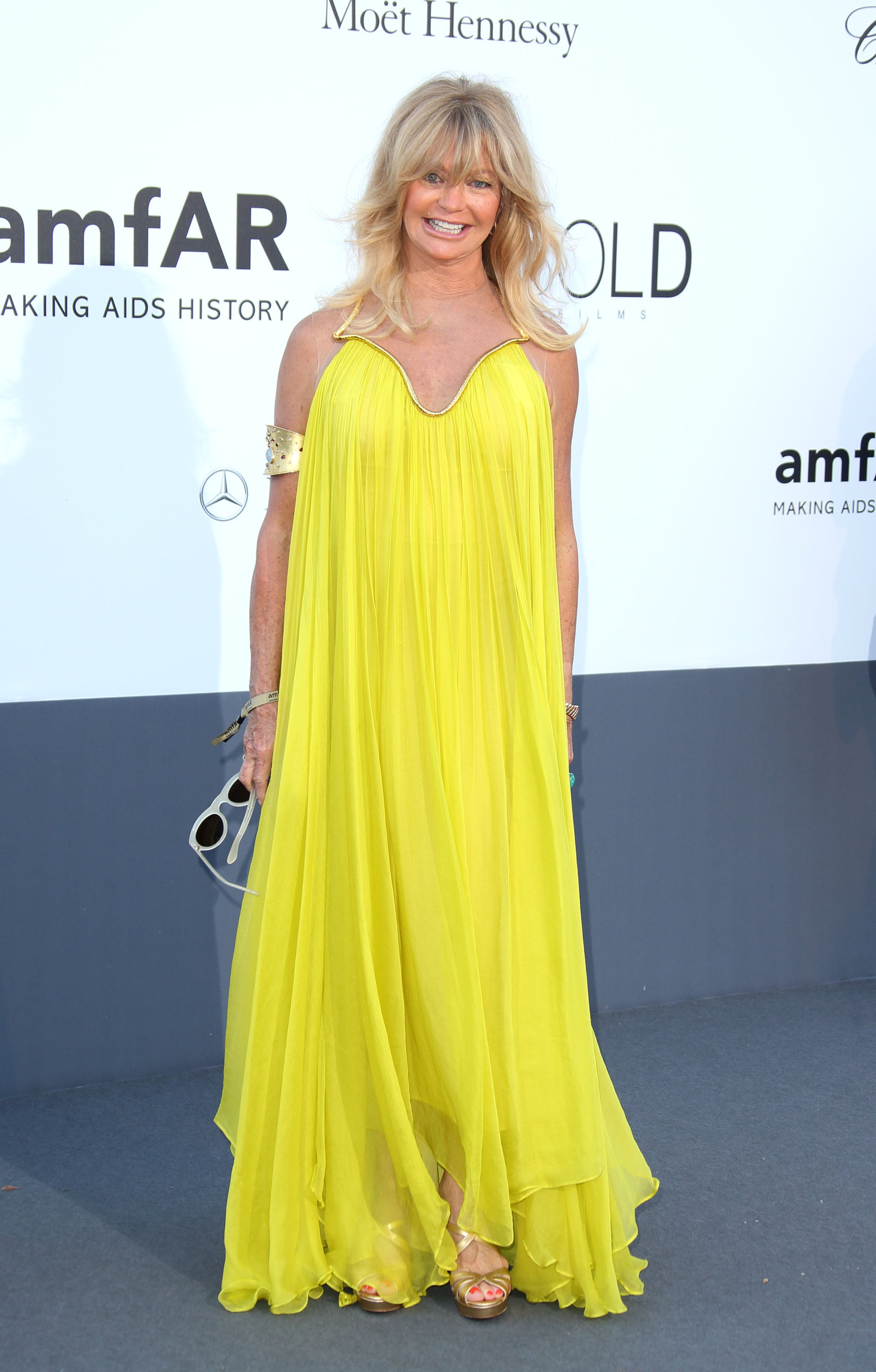 Goldie Hawn smiled in her yellow gown on Thursday for the annual amfAR gala in Cannes.