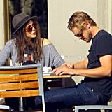 Elizabeth Olsen put her hand on Boyd Holbrook's arm at lunch.