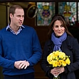 Pregnant Kate Middleton held yellow flowers as she exited the hospital.