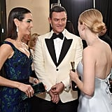 Pictured: Camilla Belle, Luke Evans, and Dakota Fanning