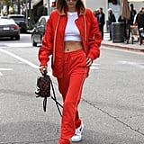 No one does athleisure like Gigi, except maybe Bella. The model wore an eye-catching red tracksuit with a pair of classic white Nike trainers.