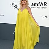 Goldie Hawn popped in her sunny yellow Maria Lucia Hohan gown and gold sandals.
