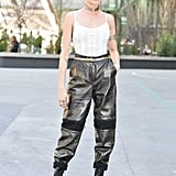Cara Delevingne joined the front row in cargo pants