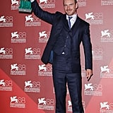 Michael Fassbender with his statue.