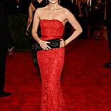 Zhang Ziyi matched the red carpet in a custom strapless and embroidered lace Jason Wu gown. She finished off the look with a Jimmy Choo gold-and-black Swarovski-studded clutch.