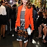Olivia Palermo brought on the colour as she arrived to the Dior Spring show wearing head-to-toe Dior. She started with a lace skirt and houndstooth bustier, then buttoned up in a sleek, bright orange blazer. Finally, she accessorized with a black and white clutch and coordinating shoes.