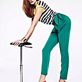 Update a plain black and white striped top with colored trousers and bright pumps.