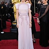 The strong-shouldered Givenchy Couture gown Cate Blanchett wore to the Academy Awards in 2011 was softened by its pale pink colour and beaded applique.