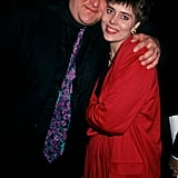 John wrapped his arms around his wife at the 1991 premiere of Stella at the Westwood Avco Theater in Westwood, CA.