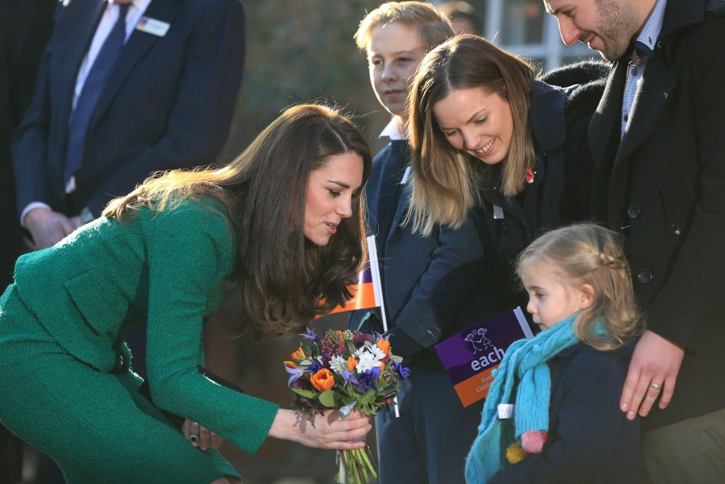 With the royal family's holiday season officially over, Kate Middleton has resumed her duties as the Duchess of Cambridge. On Tuesday, she traveled to Quidenham, Norfolk, for an official visit of East Anglia's Children's Hospices (EACH), of which Queen Elizabeth II is a Royal Patron. Her visit served the purpose of getting an update on The Nook Appeal at EACH, which is their multi-million dollar initiative to transform the way children's hospice care is handled in Norfolk. She mingled with the crowd on her way inside, and made sure to stoop down for an adorable chat with a little girl named Nell Cork, who presented her with a lovely bouquet of flowers to add to her ever-growing collection. Once inside, Kate was happy to do some arts and crafts with a group of children. Despite her upcoming move to London with Prince William and their kids, Prince George and Princess Charlotte, there's no doubt that Kate will pop up at plenty more engagements like these over the next few months.      Related:                                                                                                           What Is Kate Middleton's Relationship Like With Other Royal Women?