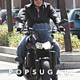 George Clooney rode a motorcycle.