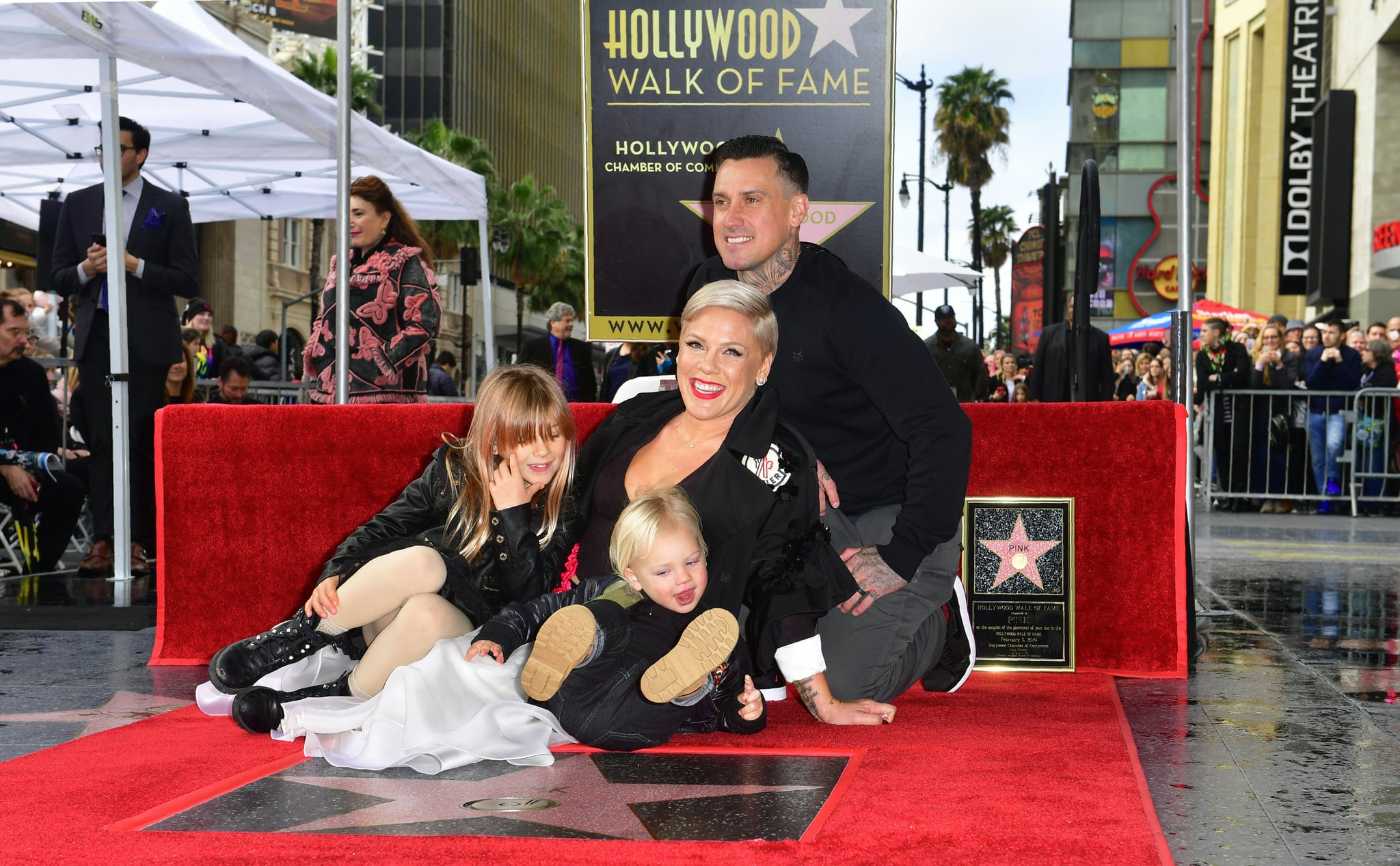 Recording artist Pink poses with her husband Carey and two children on her Hollywood Walk of Fame Star at a ceremony in Hollywood, California. (Photo by Frederic J. BROWN / AFP)        (Photo credit should read FREDERIC J. BROWN/AFP/Getty Images)