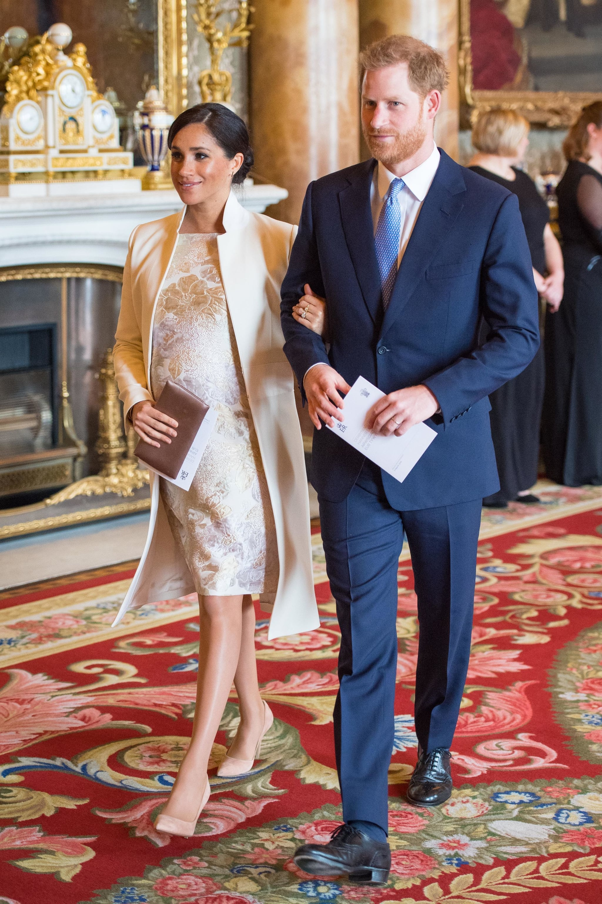 Britain's Prince Harry, Duke of Sussex, (R) and Britain's Meghan, Duchess of Sussex (L) attend a reception to mark the 50th Anniversary of the investiture of The Prince of Wales at Buckingham Palace in London on March 5, 2019. - The Queen hosted a reception to mark the Fiftieth Anniversary of the investiture of Britain's Prince Charles, her son, as the Prince of Wales. Prince Charles was created The Prince of Wales aged 9 on July 26th 1958 and was formally invested with the title by Her Majesty The Queen on July 1st 1969 at Caernarfon Castle. (Photo by Dominic Lipinski / POOL / AFP)        (Photo credit should read DOMINIC LIPINSKI/AFP/Getty Images)