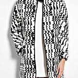 We love the idea of wearing this Vanessa Bruno Athé monochrome knit leather-trimmed coat ($316, originally $632) with leather leggings and moto boots for a laid-back look, or paired with a sheath dress and heels for a more '50s feel.